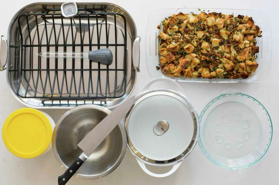 Must-have tools include, from left: a roasting pan with rack, baster, instant thermometer, glass baking dish, glass pie plate, casserole pot, mixing bowl, chef's knife and storage containers.  Photo: Sarah Crowder, HONS / Katie Workman
