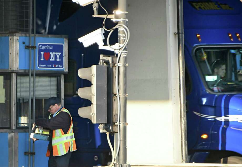 A toll collector takes his money drawer back to the office at the Thruway exit 24 toll booths on Monday, Nov. 13, 2017 in Albany, N.Y. (Lori Van Buren / Times Union) Photo: Lori Van Buren, Albany Times Union / 20042116A