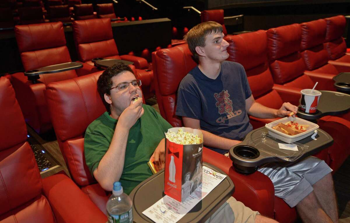Evan Roberts and Jack Guild settle in to watch Dunkirk Thursday, August 23, 2017, at the newly renovated Bow Tie Cinemas Royale 6 on Westport Avenue in Norwalk, Conn. In an effort compete with at-home streaming and make the theater an experience once again, Norwalk?'s Bow Tie theater?'s are stepping up their game with recliners, full bars and food menus. Credit:Erik Trautmann / Hearst Connecticut Media