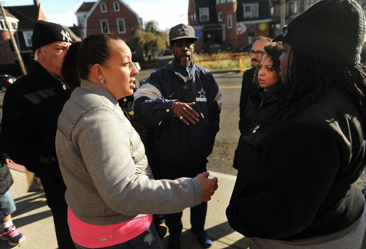 From left; Bridgeport City Council members Eneida Martinez and Ernest Newton meet with Antionette Rogers and Tiffany Elliott, sister and aunt to Aaron Kearney, during a protest outside Police Headquarters in Bridgeport, Conn. on Sunday, November 12, 2017. Kearney's family members are calling for quick disciplinary action for an officer they say repeatedly punched Kearney in the head while he was being held down by other officers.