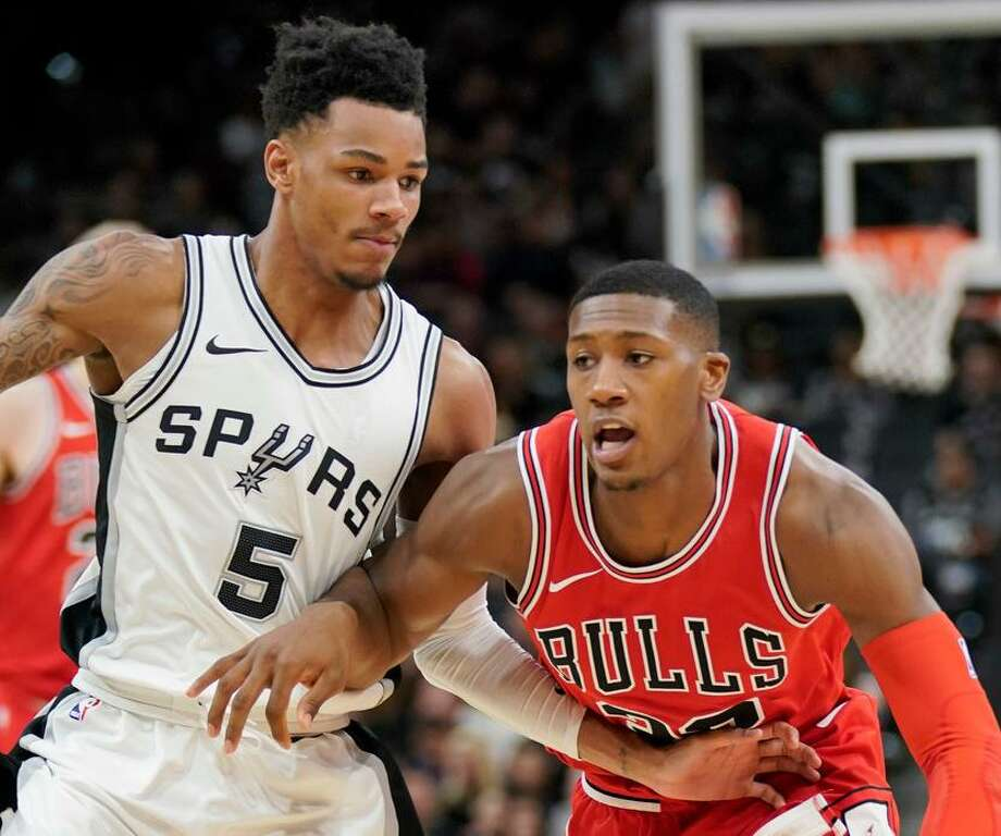 Defense and rebounding are Dejounte Murray's strengths now as he showed Saturday in a lopsided win over Chicago. Photo: Darren Abate /AP Photo