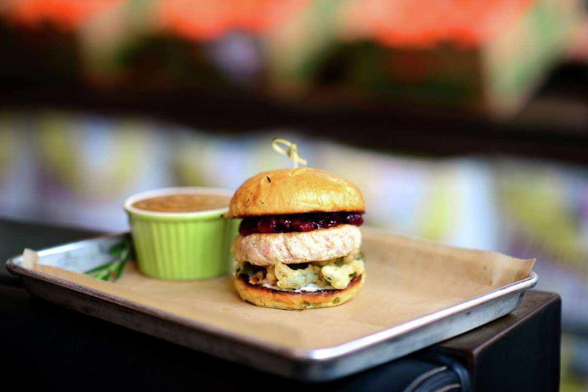 Hopdoddy Burger Bar offers a Thanksgiving-inspired turducken burger with fried green beans and cranberry sauce on a stuffing bun through Nov. 22.