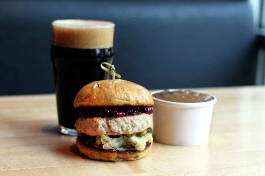 Hopdoddy Burger Bar offers a Thanksgiving-inspired turducken burger with fried green beans and cranberry sauce on a stuffing bun through Nov. 22. Photo: Hopdoddy