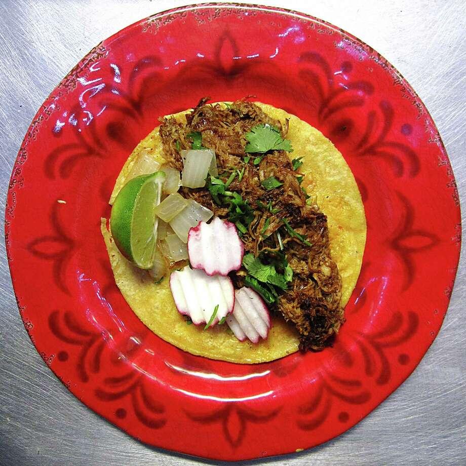 Pork birria taco on a corn tortilla with onions, cilantro and radishes from the taco truck El Bandolero. Photo: Mike Sutter /San Antonio Express-News