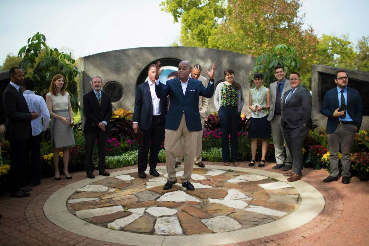 Harris County Commissioner Rodney Ellis talks about the Park-Smart Precinct One, surrounded by members of the project's steering committee, at Mickey Leland Memorial Park.