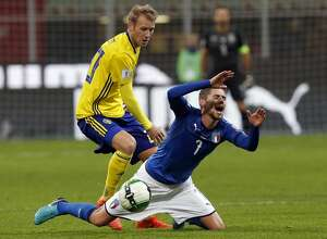 Italy's Jorginho, right, is fouled by Sweden's Ola Toivonen during the World Cup qualifying play-off second leg soccer match between Italy and Sweden, at the Milan San Siro stadium, Italy, Monday, Nov. 13, 2017. (AP Photo/Antonio Calanni)