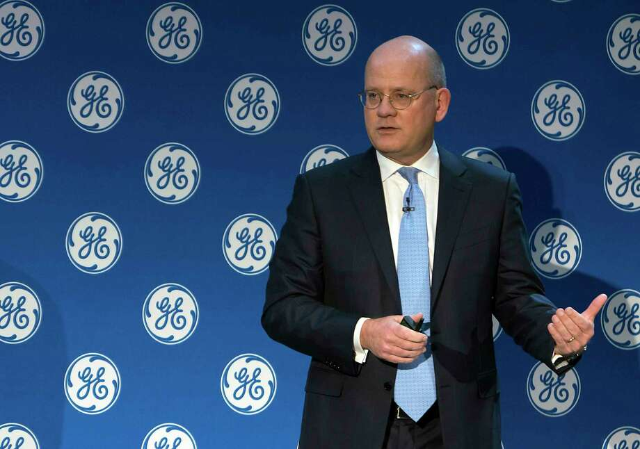 TIMELINE: Largest oil mergers of the past 20 years ...In this Monday, Nov. 13, 2017, photo provided by General Electric, GE Chairman and CEO John Flannery addresses investors at a meeting in New York. Flannery said the company is weighing the future of its transportation, industrial, and lighting businesses so that it can focus more intently on its most profitable divisions. (Eli Kabillio/General Electric via AP) Photo: Eli Kabillio, HONS / General Electric