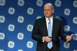In this Monday, Nov. 13, 2017, photo provided by General Electric, GE Chairman and CEO John Flannery addresses investors at a meeting in New York. Flannery said the company is weighing the future of its transportation, industrial, and lighting businesses so that it can focus more intently on its most profitable divisions. (Eli Kabillio/General Electric via AP)