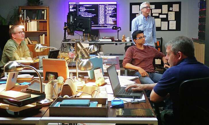 """Cryptologist and artificial-intelligence expert Kevin Knight, standing, and his team attempt to crack the code that will uncover the name of the Zodia Killer in the five-part limited series """"The Hunt for the Zodiac Killer."""""""
