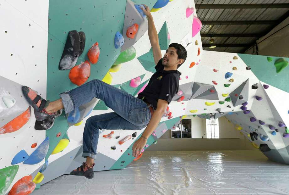 Momentum Indoor Climbing general manager Joey Luna shows how it's done. He started climbing in Colorado's mountains. Photo: Melissa Phillip, Houston Chronicle / © 2017 Houston Chronicle