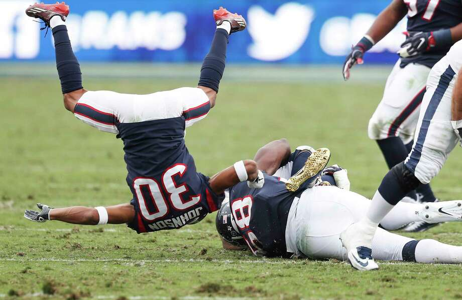 Houston Texans cornerback Kevin Johnson (30) flips in the air after tackling Los Angeles Rams running back Todd Gurley during the third quarter of an NFL football game at the Los Angeles Memorial Coliseum on Sunday, Nov. 12, 2017, in Los Angeles, Mass. ( Brett Coomer / Houston Chronicle ) Photo: Brett Coomer, Staff / © 2017 Houston Chronicle