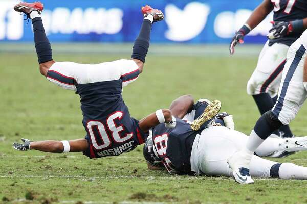 Houston Texans cornerback Kevin Johnson (30) flips in the air after tackling Los Angeles Rams running back Todd Gurley during the third quarter of an NFL football game at the Los Angeles Memorial Coliseum on Sunday, Nov. 12, 2017, in Los Angeles, Mass. ( Brett Coomer / Houston Chronicle )