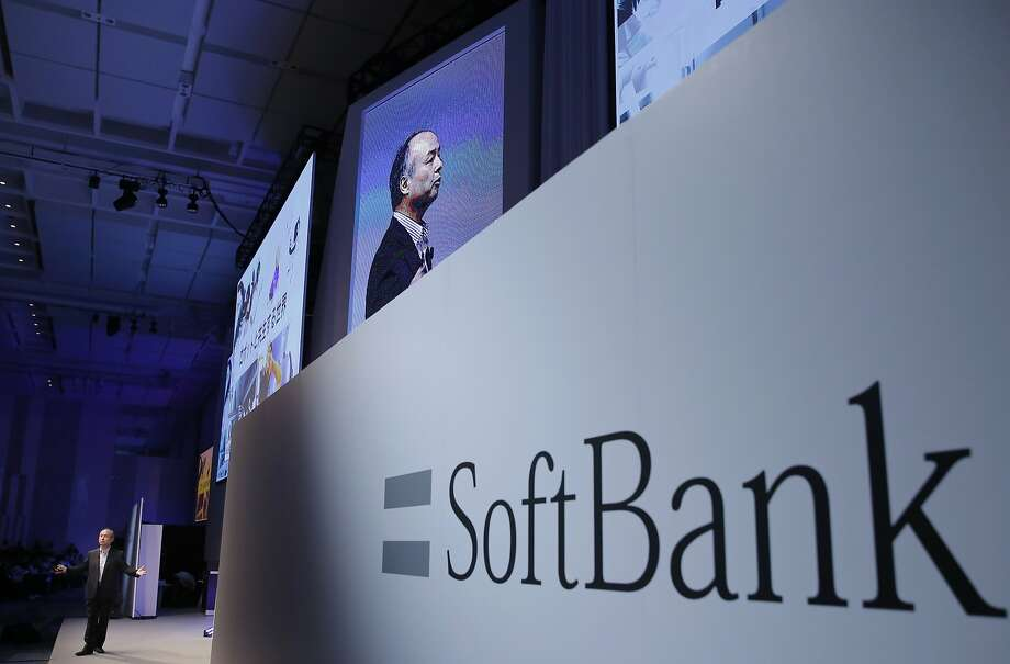SoftBank CEO Masayoshi Son speaks at a presentation in July. The Japanese firm is offering to buy Uber shares. Photo: Shizuo Kambayashi, Associated Press