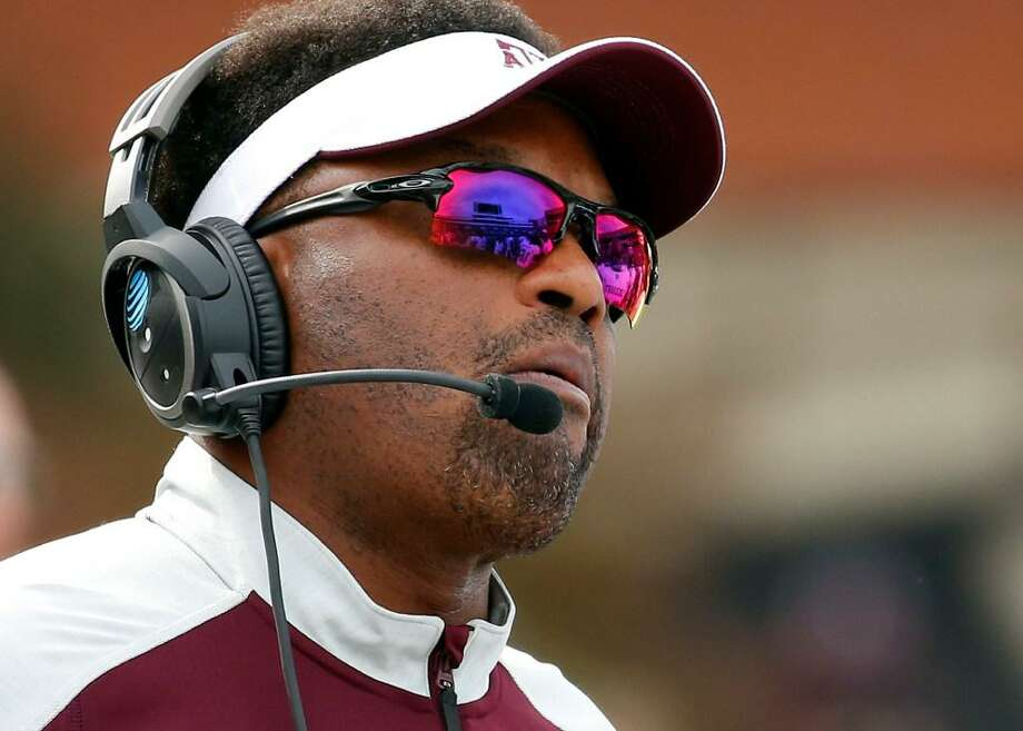In this Saturday, Nov. 5, 2016 file photo, Texas A&M head coach Kevin Sumlin watches a play on the stadium video screen in the first half of an NCAA college football game against Mississippi State in Starkville, Miss. Texas A&M starts the season at UCLA on Sunday night, Sept. 3, 2017 and the losing coach will immediately face a frustrated fanbase. Aggies coach Kevin Sumlin has been rattling off solid seasons for the last four years, but solid might not be enough to solidify his status with athletic director Scott Woodward. Photo: Rogelio V. Solis /AP Photo