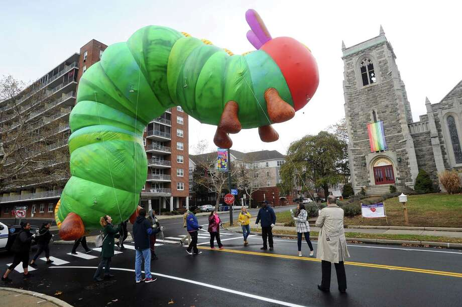 Volunteers practice walking with the 35-foot long inflatable Very Hungry Caterpillar balloon along Walton Place following the 2017 Stamford Downtown Parade Spectacular press conference held in Latham Park in downtown Stamford, Conn. on Monday, Nov. 13, 2017. Photo: Michael Cummo / Hearst Connecticut Media / Stamford Advocate