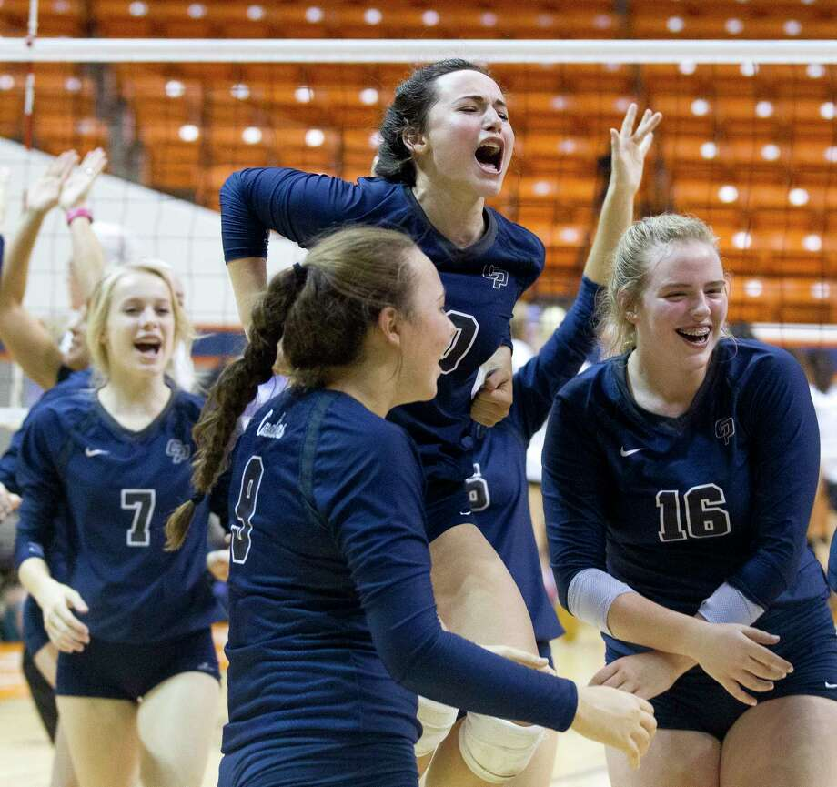 College Park players celebrate after their straight set victory over Klein Oak during a Region II-6A semifinal match at Johnson Coliseum, Friday, Nov. 10, 2017, in Huntsville. Photo: Jason Fochtman, Staff Photographer / © 2017 Houston Chronicle