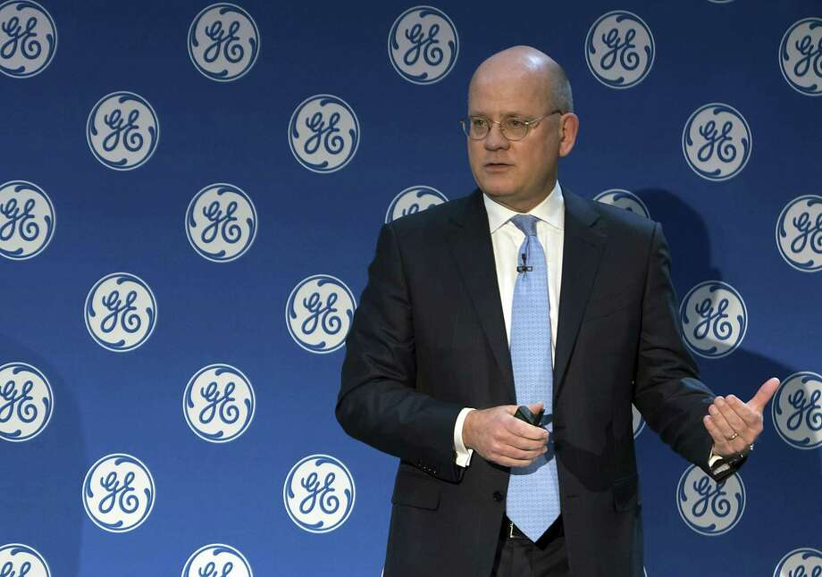 In this Monday, Nov. 13, 2017, photo provided by General Electric, GE Chairman and CEO John Flannery addresses investors at a meeting in New York. Flannery said the company is weighing the future of its transportation, industrial, and lighting businesses so that it can focus more intently on its most profitable divisions. (Eli Kabillio/General Electric via AP) Photo: Eli Kabillio / Associated Press / General Electric