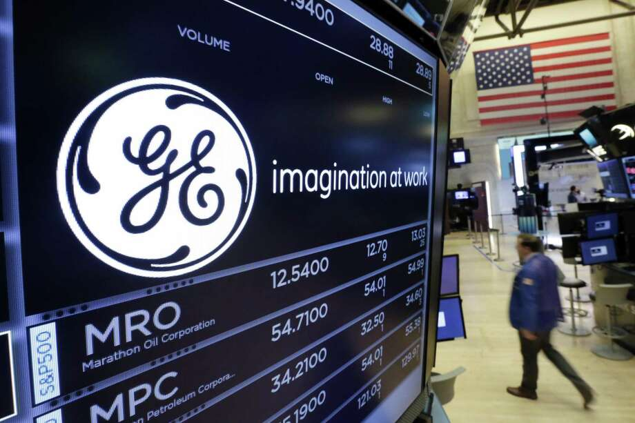 FILE - In this Monday, June 12, 2017, file photo, the General Electric logo appears above a trading post on the floor of the New York Stock Exchange.  (AP Photo/Richard Drew, File) Photo: Richard Drew / Associated Press / AP