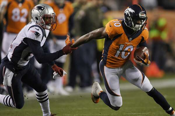 DENVER, CO - NOVEMBER 12: Malcolm Butler (21) of the New England Patriots tries to tie up Emmanuel Sanders (10) of the Denver Broncos during the first quarter on Sunday, November 12, 2017. The Denver Broncos hosted the New England Patriots. (Photo by Joe Amon/The Denver Post via Getty Images)