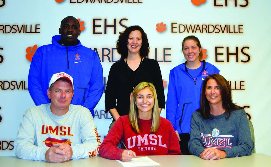 EHS senior Megan Woll, seated center, will play volleyball at UMSL.