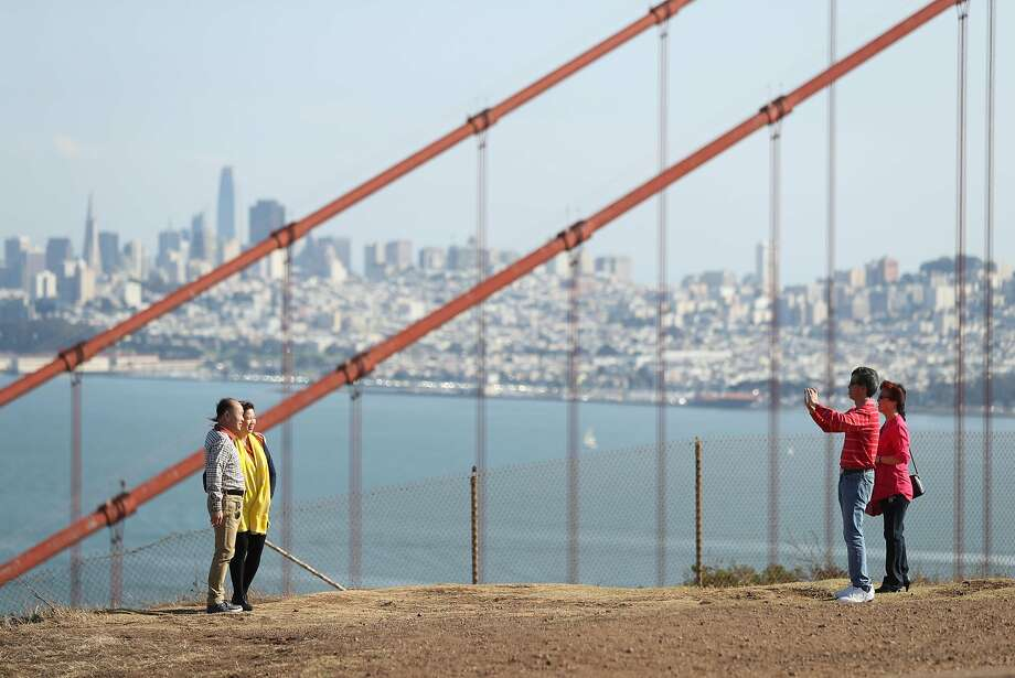 San Francisco, viewed through the bridge cables from the Marin Headlands. Photo: Scott Strazzante, The Chronicle