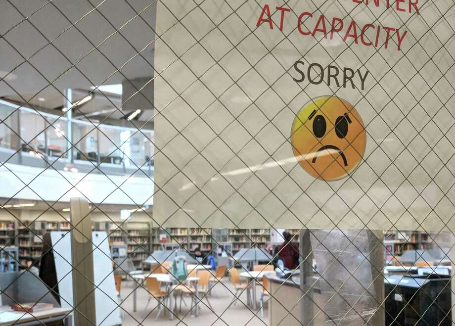 A sign outside the media center at AITE says that students can not enter because the center is at capacity, despite it being devoid of many students. Photo: Contributed / Contributed Photo / Stamford Advocate  contributed