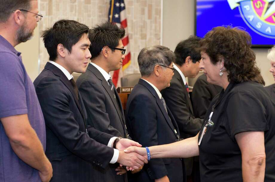 Pasadena city employees and officials greet a delegation from Hadano, Japan, that brought a donation for city workers recovering from Hurricane Harvey. Hadano is a sister city to Pasadena through Sister Cities International.