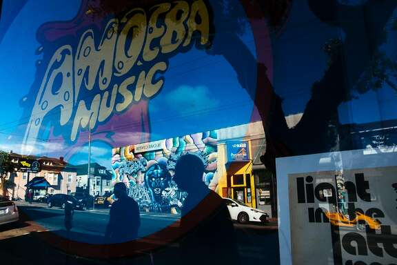 People walk past the Amoeba Music records on Haight Street in San Francisco, Calif. Monday, October 30, 2017.