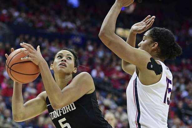UConn's Gabby Williams, right, defends Stanford's Kaylee Johnson during Sunday's game in Columbus, Ohio.