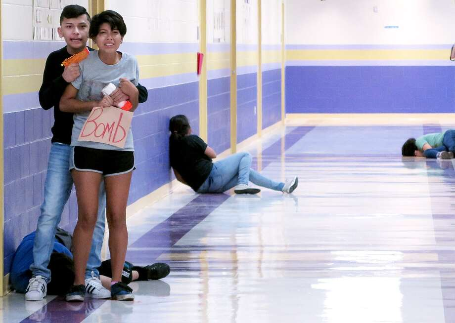 LISD students and the district safety officials set up a hostage taking and active shooter scenarios as training exercises for the Laredo Independent School District Police Department in August at Leyendecker Elementary. It's regretable that such drills have to occur. Photo: Cuate Santos / / Laredo Morning Times