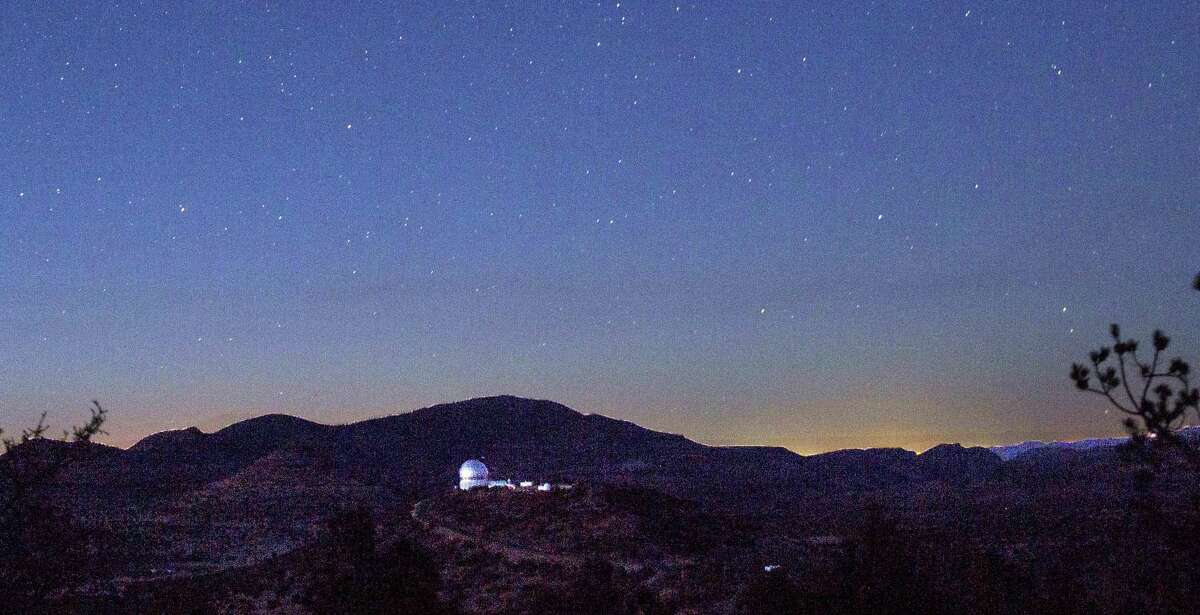 Looking in the direction of Balmorhea, stars appeared above the mountains and the Hobby-Eberly Telescope at the McDonald Observatory near Fort Davis, Texas on March 27, 2017. The view from the observatory now includes the glow from the Permian Basin oil field, incandescent with the work of 24-hour drilling, fracking and gas flaring.