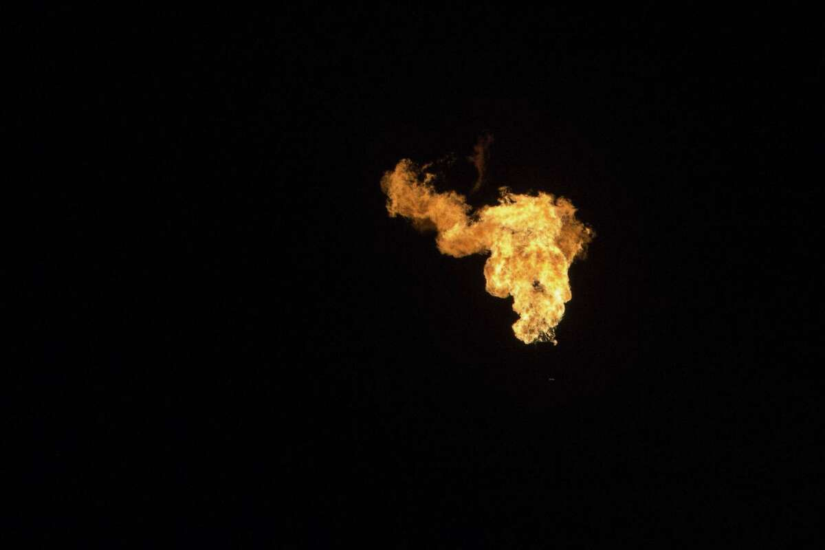 A flare is seen off I-10 near Balmorhea, Texas on March 27, 2017. Permian Basin producers burned off between 3 and 4 percent of their natural gas, higher than the state average, in 2014 and 2015, according to a report being released Tuesday by the Environmental Defense Fund.