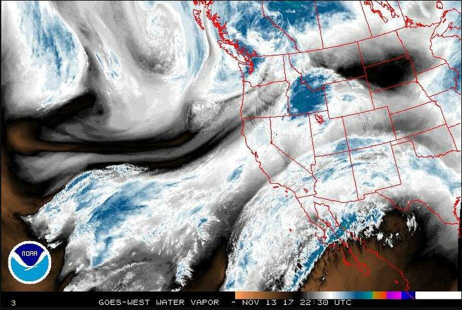 A satellite image from Monday afternoon shows visible water vapor over the western half of the United States. The storm system moving inland over the Northwest was already bringing high winds and rain to the Seattle area and beyond. Photo: National Weather Service