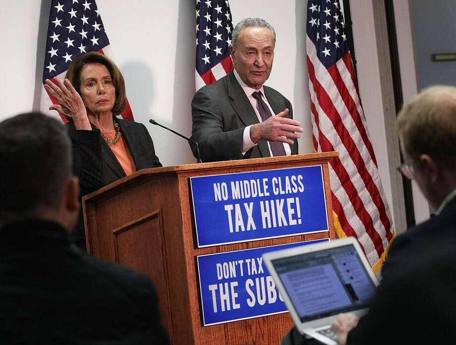 U.S. Senate Minority Leader Sen. Chuck Schumer (D-NY) and House Minority Leader Rep. Nancy Pelosi (D-CA) participate in a news conference November 13, 2017 at the Democratic National Committee headquarters in Washington, DC. Schumer and Pelosi held the news conference to discuss the Republican's tax reform plan. Photo: Alex Wong / Getty Images / 2017 Getty Images
