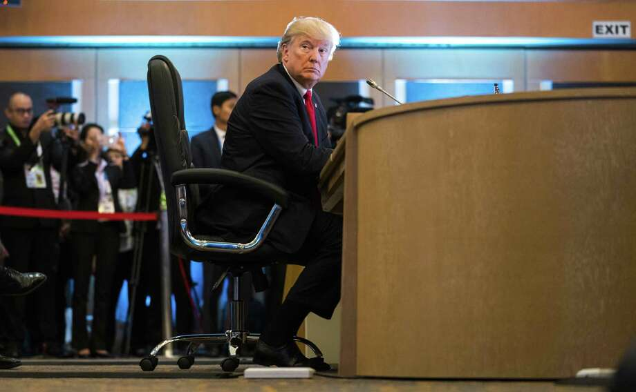 As Republican lawmakers worked toward a delicate compromise on a $1.5 trillion tax cut, President Donald Trump - shown here at Association of Southeast Asian Nations summit meeting in Manila on Monday - threw himself back into the discussion, suggesting that Republicans could slash taxes even further by repealing the Affordable Care Acts mandate that most people have health insurance. (Doug Mills/The New York Times) Photo: DOUG MILLS / NYT / NYTNS
