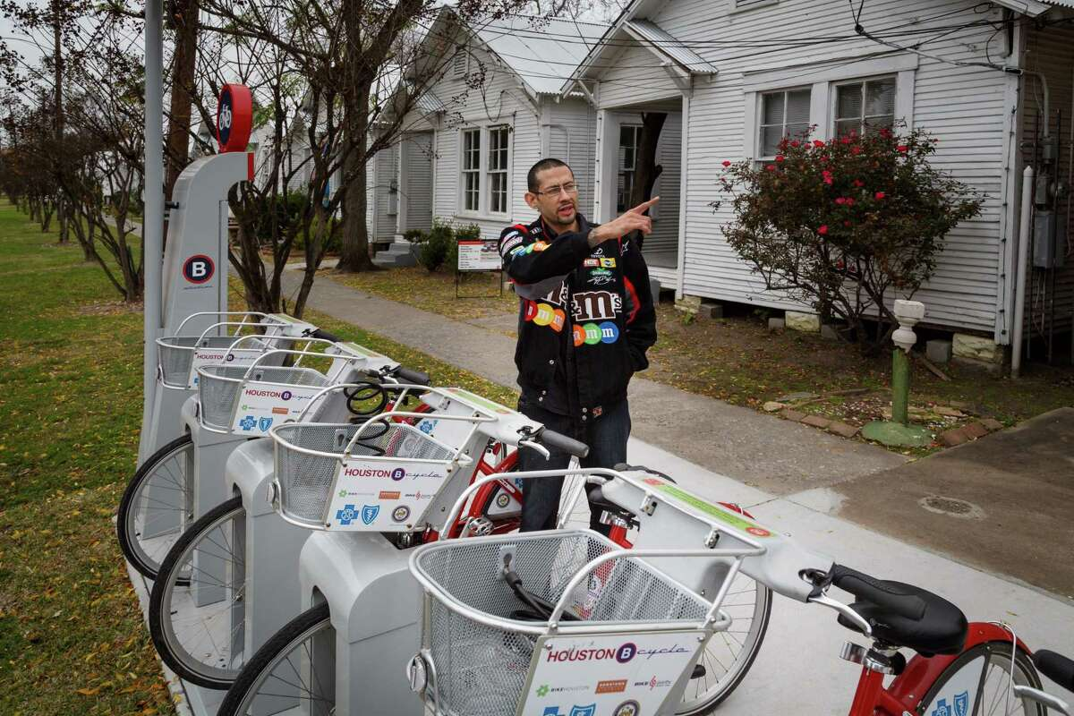 Eric Munoz points to where he lives while looking at the B-Cycle kiosk near the Project Row Houses in the 3rd Ward, Monday, Dec. 30, 2013, in Houston. ( Michael Paulsen / Houston Chronicle )