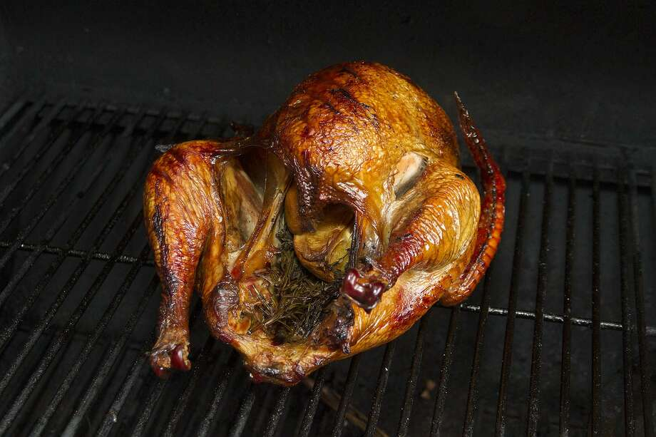 The turkey should be pulled off the smoker when the internal temperature in the thickest parts of the bird reaches 165 degrees with a meat thermometer. Photo: Alma E. Hernandez /For The Express-News