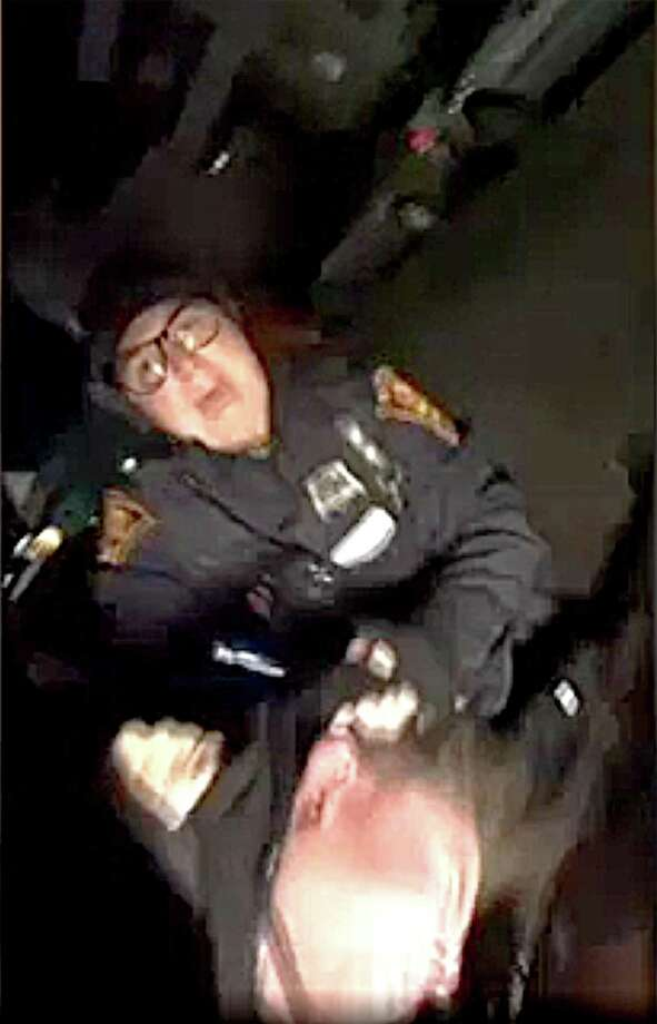 An image taken from a cell phone video shows Bridgeport Police Officer Christina Arroyo during the arrest of Aaron Kearney, 18, of Bridgeport following a traffic accident last Friday evening, Nov. 10, 2017. Arroyo and other officers have been placed on administrative status after allegations that they beat Kearney in the incident. Credit: Contributed Photo: Contributed Photo / Contributed Photo / Connecticut Post Contributed