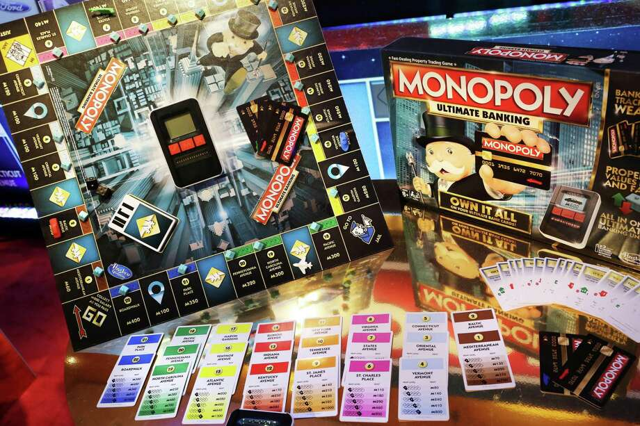In this Monday, Feb. 15, 2016, file photo, the Monopoly Ultimate Banking Game from Hasbro is displayed at Toy Fair in New York. Shares of Mattel soared in after-hours trading Friday, Nov. 10, 2017, after a report that rival Hasbro has made a takeover offer for Mattel. Such a deal could bring together well-known brands like Monopoly, Nerf, Barbie and Hot Wheels. Photo: Mark Lennihan /Associated Press / Copyright 2017 The Associated Press. All rights reserved.