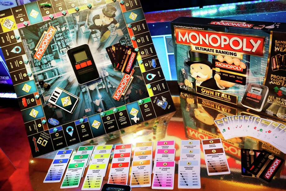 FILE - In this Monday, Feb. 15, 2016, file photo, the Monopoly Ultimate Banking Game from Hasbro is displayed at Toy Fair in New York. Shares of Mattel soared in after-hours trading Friday, Nov. 10, 2017, after a report that rival Hasbro has made a takeover offer for Mattel. Such a deal could bring together well-known brands like Monopoly, Nerf, Barbie and Hot Wheels. (AP Photo/Mark Lennihan, File) ORG XMIT: NYBZ516 Photo: Mark Lennihan / Copyright 2017 The Associated Press. All rights reserved.