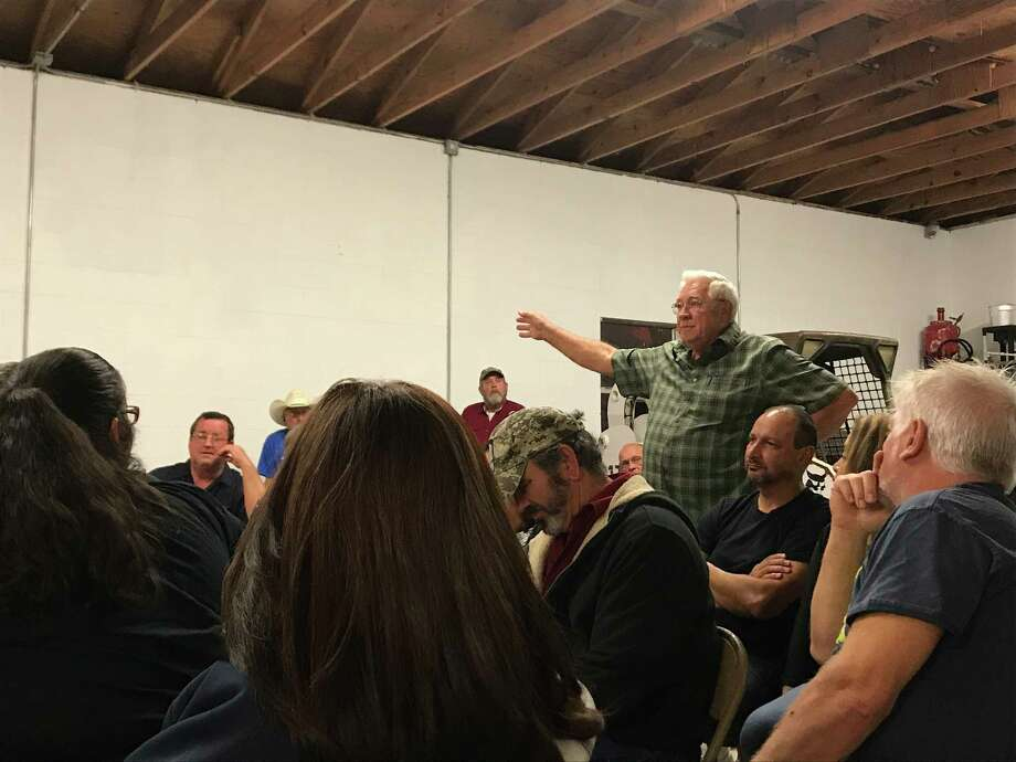 Scotty Langston address Manvel Mayor Debra Davison at a meeting organized by residents concerned about a proposal for the city to annex their property.