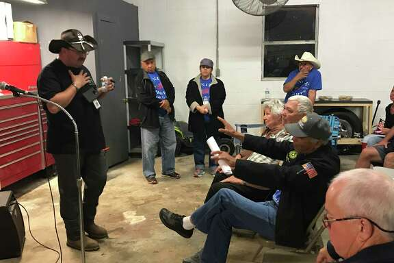 Manvel City Councilman Adrain Gaspar talks recently with Brazoria County residents who oppose annexation of their homes. The city has agreed to drop plans to annex inhabited land in its extraterritorial jurisdiction.