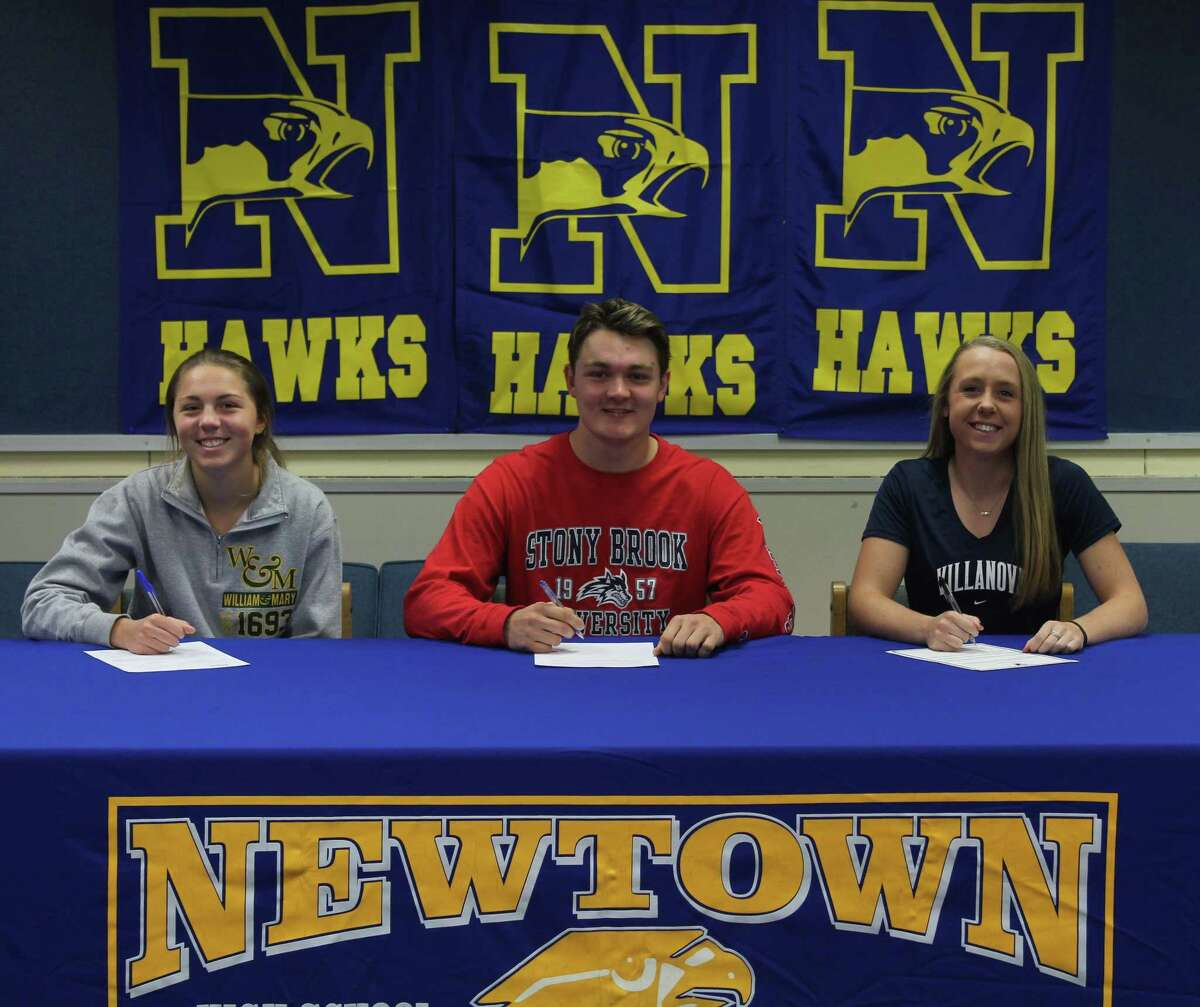 Newtown High School senior student-athletes, from left, Sarah Houle, Layton Harrell and Sara Kennedy, sign their National Letters of Ingtent to play their respective sports in college during a ceremony at the school Nov. 13, 2017. Houle will play golf at William and Mary, Harrell will play lacrosse at Stony Brook and Kennedy will play softball at Villanova.