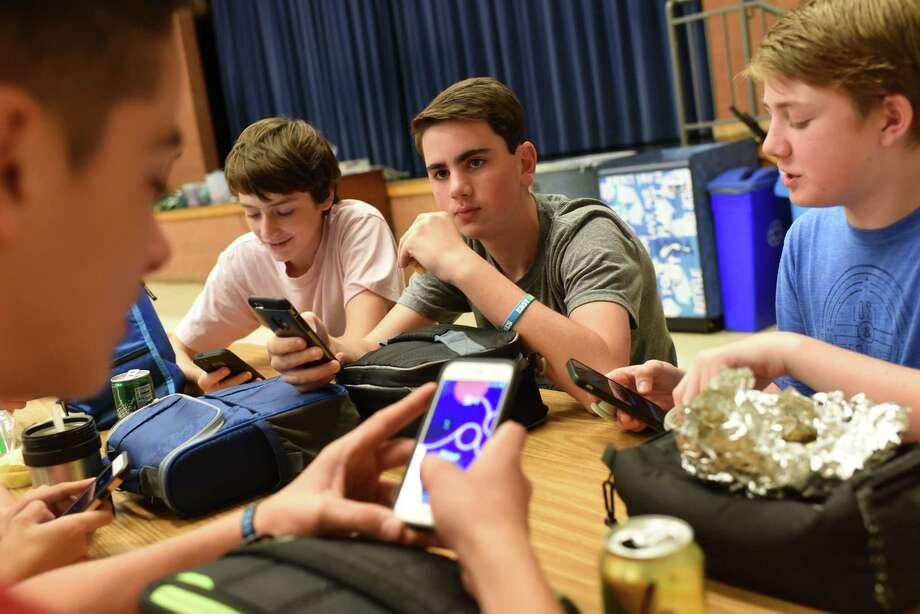 From left, Jack Doyle, 13, Ryan Ward, 14, Aiden Franz, 13, and Gray Rager, 14, use their cell phones during lunch at Westland Middle School in Bethesda, Md. Photo: Washington Post Photo By Michael Robinson Chavez / The Washington Post