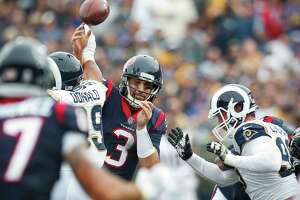 Texans quarterback Tom Savage (3) had trouble keeping control of the ball Sunday against the Los Angeles Rams, losing two fumbles in addition to throwing two interceptions.