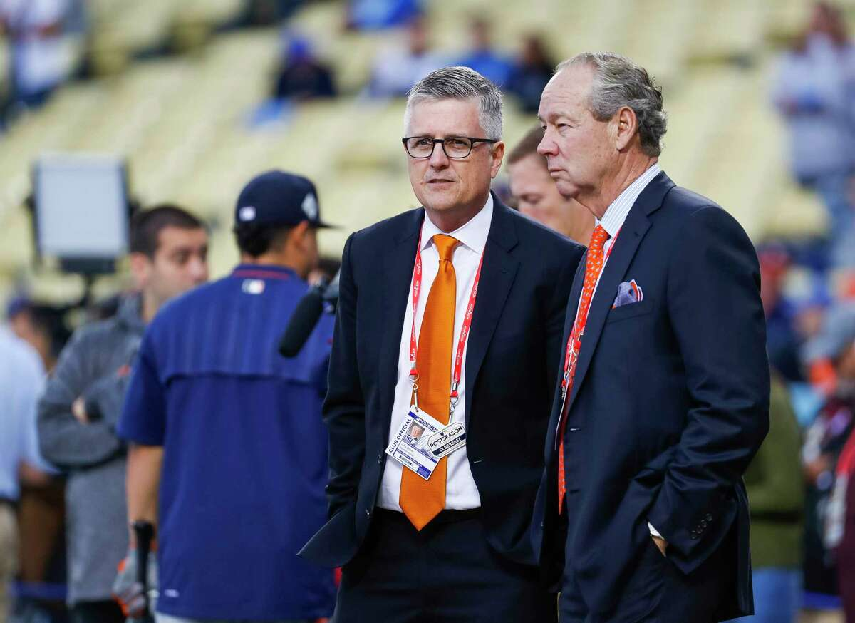Astros general manager Jeff Luhnow and owner Jim Crane watch batting practice before Game 6 of the World Series at Dodger Stadium on Tuesday, Oct. 31, 2017, in Los Angeles. ( Karen Warren / Houston Chronicle )