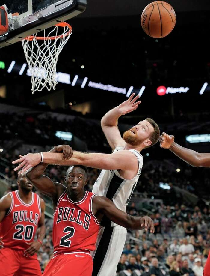 San Antonio Spurs forward Matt Costello draws a foul against Chicago Bulls guard Jerian Grant (2) on Saturday in San Antonio. Costello, a Bay City Western graduate, made his NBA debut. (AP Photo/Darren Abate)