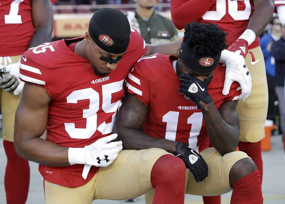 San Francisco 49ers safety Eric Reid (35) and wide receiver Marquise Goodwin (11) kneel during the performance of the national anthem before an NFL football game against the New York Giants in Santa Clara, Calif., Sunday, Nov. 12, 2017. (AP Photo/Marcio Jose Sanchez) Photo: Marcio Jose Sanchez, Associated Press