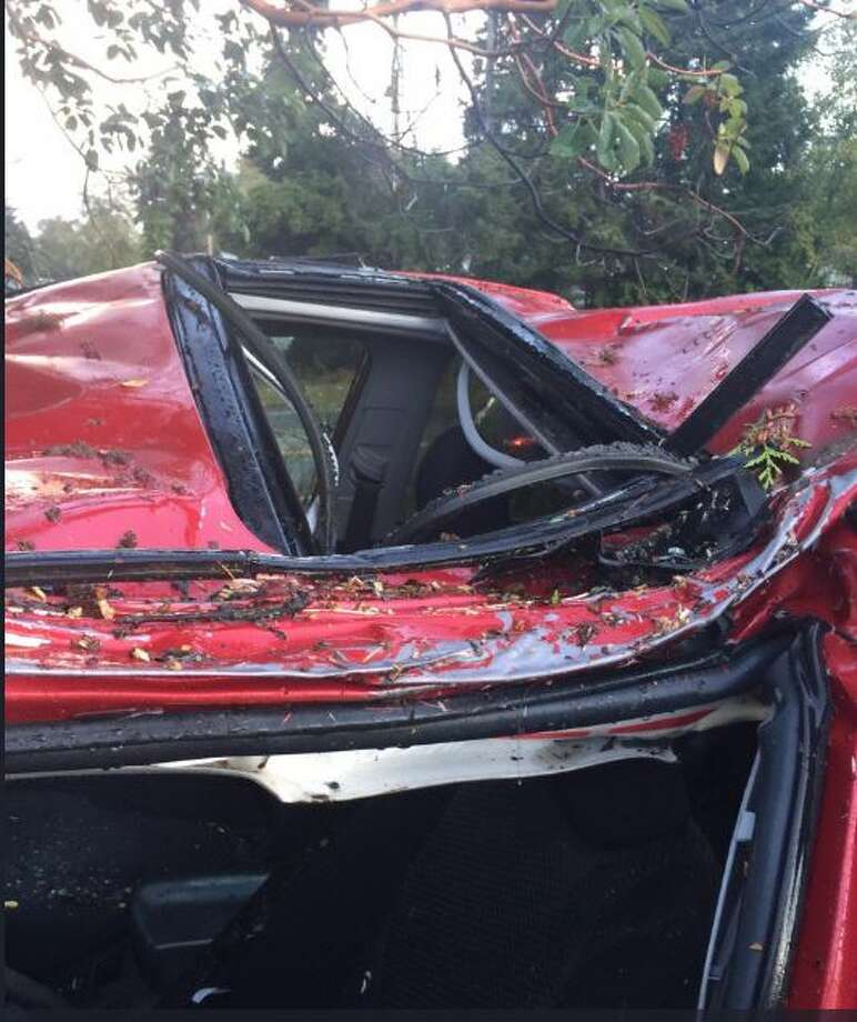 Two people suffered non-life threatening injuries when a falling tree limb struck their car in Chimacum Monday afternoon. Washington State Patrol Trooper Russ Winger tweeted this photo of the vehicle. Photo: WSP