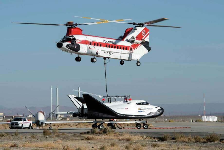 This Nov. 11, 2017 photo provided by Sierra Nevada Corporation shows the Dream Chaser spacecraft being lifted by a helicopter prior to a test flight at Edwards Air Force Base, Calif. The Sierra Nevada Corp. says its Dream Chaser had a successful free-flight drop test in the Mojave Desert on Saturday, Nov. 11, 2017. (Ken Ulbrich/NASA via AP) Photo: Ken Ulbrich, HOGP / NASA